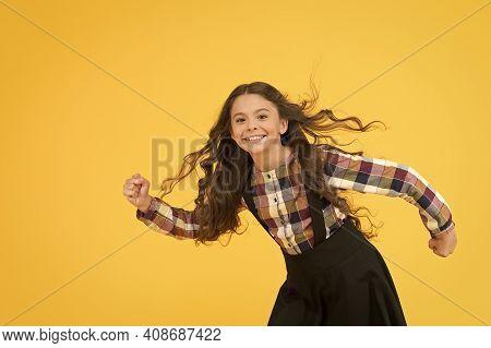 Activity School. Energetic Child Hurry To School. Small Child Wear School Uniform Yellow Background.