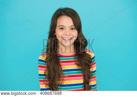 Hair Like Fire. Express Positive Emotions. Happy Small Girl Turquoise Background. Cheerful Schoolgir
