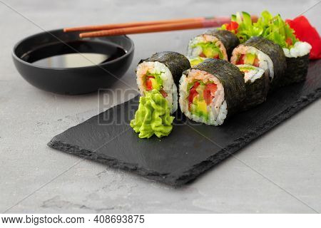 Vegeterian Sushi Roll With Vegetables On Stone Plate
