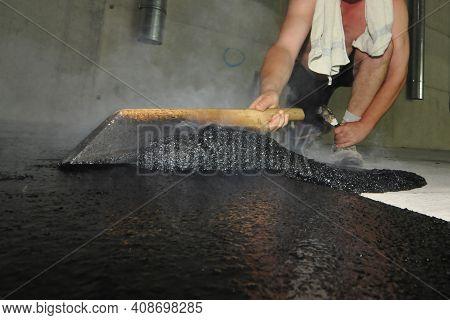 Hot Liquid Mastic Asphalt On The Floor