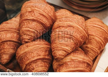 Delicious Croissant, Warm Fresh Buttery Croissants And Rolls On Dark Wooden Table, Close Up. French