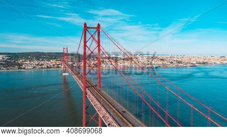 Drone Photo Of Red 25 De Abril Bridge In Lisbon Which Connecting Lisbon City And Almada Across The T