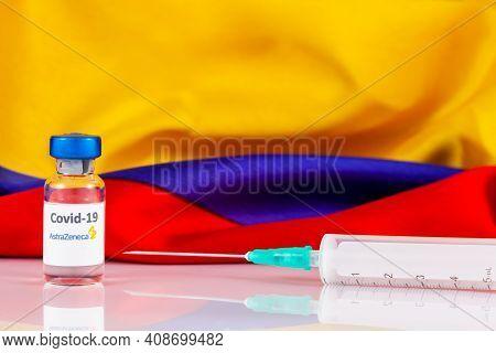 Bogota, Colombia - February 2021. Astrazeneca Covid Vaccine Vial And Colombian Flag. Vaccination Con