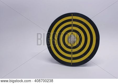 Concept Of Success And Goal Achievement. Round Dart Board With A Bitcoin Coin In The Center Of The C