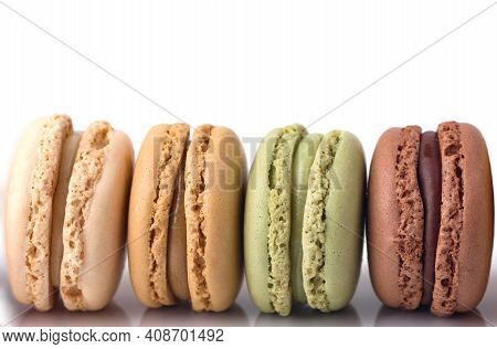 Four Macarons In A Row On White Background