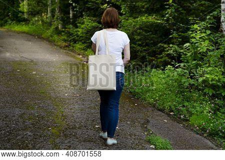 Walking Woman Holding Tote Bag Mockup