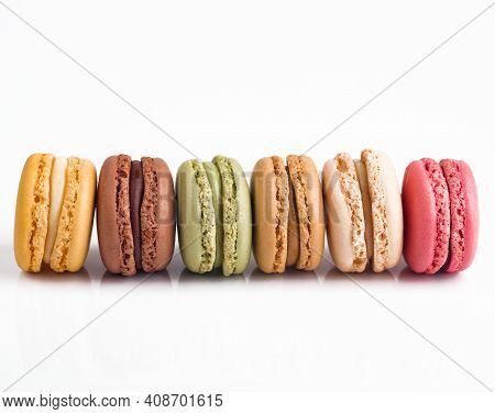 Colorful Macarons In A Row On White Background