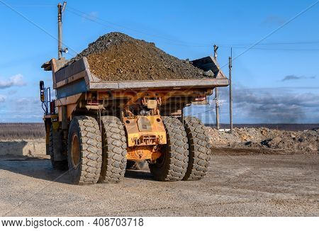 Mining Truck Dump Truck Loaded With Ore. Transportation Of Mined Ore From The Open Pit To The Surfac