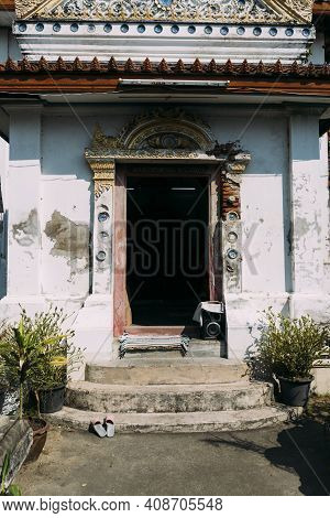 Old, Beat-up Doorway Entrance To White Buddhist Temple In Pak Nam, Thailand, With Peeling Paint.