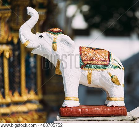 Small White Elephant Statue Outside Temple In Thailand.