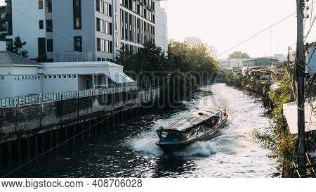 Bangkok Canal Boat Cruises Through Khlong In Downtown Bangkok At Sunset.