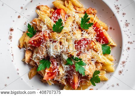 Penne Pasta In Tomato Bolognese Sauce, Chicken Meat And Parmesan Cheese. Quick Delicious Pasta Meal
