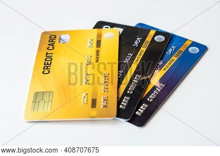 Close Up Of A Set Of Cradit Cards Isolated On White Background. Credit Card Lets Cardholders Borrow