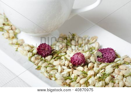White Tea Cup and Dry Flowers