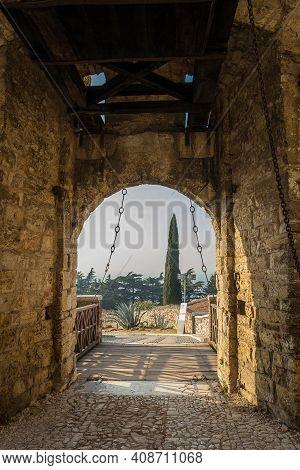 Stone Wall With Merlons And Drawbridge Gate Of Medieval Castle Of Brescia Or Castello Di Brescia Or