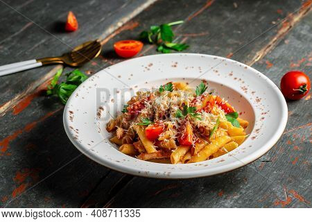 Penne Pasta In Tomato Bolognese Sauce With Chicken, Tomatoes Served With Parmesan Cheese. Pasta Al P