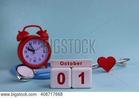 October 1. Day 1st Of Month, Calendar Date. White Wooden Calendar Blocks With Date, Clock And Stetho