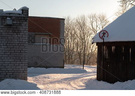 No Entry Sign For People. Entrance To A Private Area With Wooden And Brick Buildings