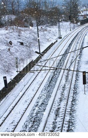 Snowy Railway Track. Endless Snowstorms Can Interrupt Traffic. It Snows And Freezes A Lot. The Track