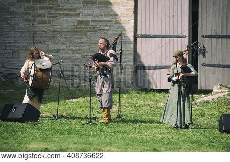 Staraya Ladoga, Saint-petersburg, Russia - June 22, 2019: Medieval Bagpipers And Drummer At The Summ