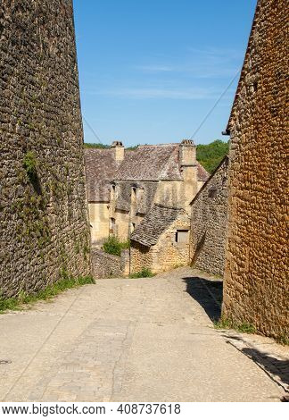 Typical French Townscape With Ancient Housest And Cobblestone Street In The Traditional Town Beynac-