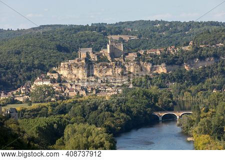 The Medieval Chateau De Beynac Rising On A Limestone Cliff Above The Dordogne River Seen From Castel
