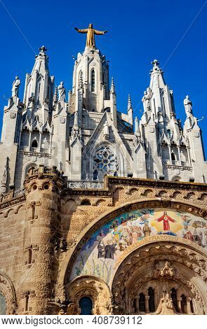 BARCELONA, SPAIN - NOV 07-2020: Tibidabo church on mountain in Barcelona with christ statue overviewing the city