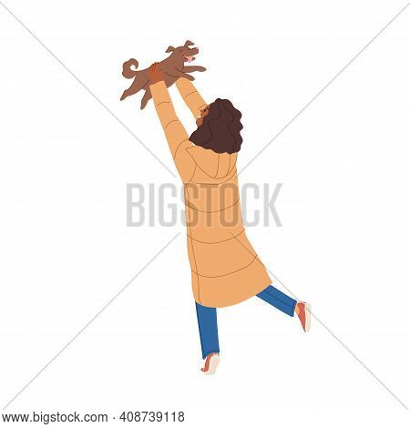 Dog Owner Playing With Her Pet And Tossing It Up. African American Woman Happy About Finding Or Buyi