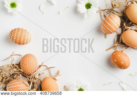 Happy Easter Concept. Frame Of Elegant Easter Eggs And Spring Flowers On White Background. Flat Lay,