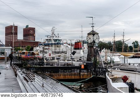 Oslo, Norway - August 10, 2019: View Of The Port Of Aker Brygge With City Hall On Background