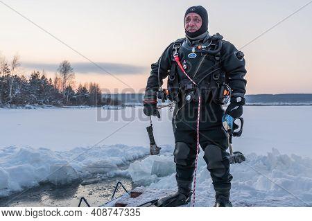 Russia, River Volga Kama - Jan 17th 2020. Diver Before Scuba Ice Diving. Outdoor Winter Diving Under