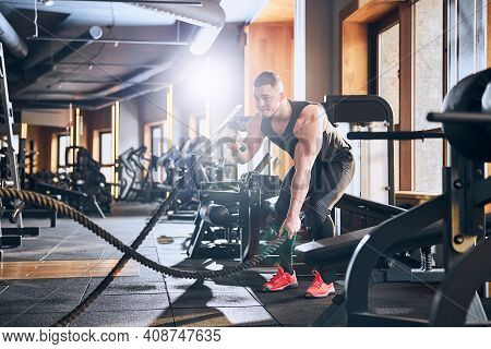 Athletic Young Man Doing Hiit Workout In Gym