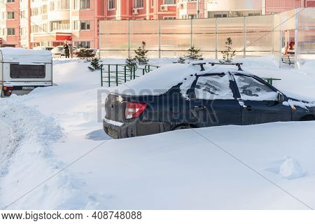 Moscow. Russia. February 2020. Snowfall In February. Car In A Snowdrift. After A Heavy Snowfall, The
