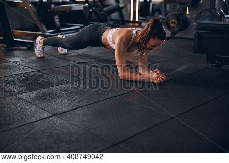 Beautiful Slim Woman Training Core In Gym