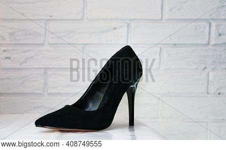 Black High-heeled Shoes. Women's Shoes With Heels. A Pair Of Women's Black Patent Leather Shoes On A