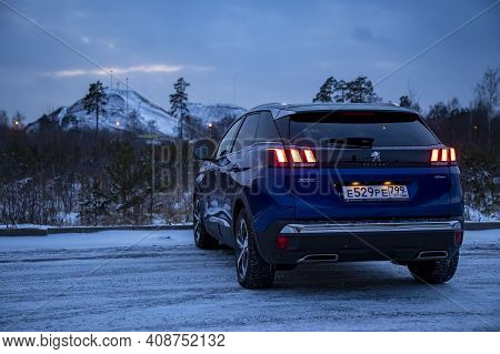 Moscow, Russia - March 15, 2020: Rear View Blue Suv Peugeot 3008 On On Winter Landscape. Rear Lights