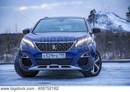 Moscow, Russia - March 15, 2020:  Blue Suv Peugeot 3008 On On Winter Landscape.