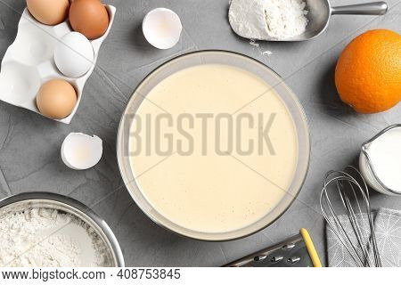 Flat Lay Composition With Batter And Ingredients On Grey Table