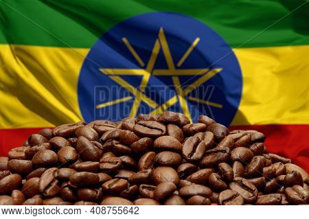 Roasted Coffee Beans On The Background Of The Flag Of Ethiopia. Concept: Best Flavored Coffee, Expor