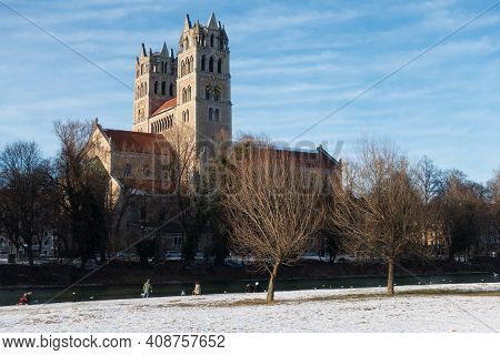 View From The Isar River Water Front On St. Maximilian Roman Catholic Parish Church, On Sunny Winter