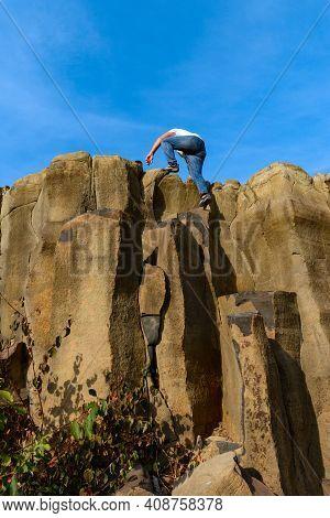 Tourists Climb Up The Basalt Pillars, Tourist Places Of Ukraine, Natural Stone Of The Basalt Rock.