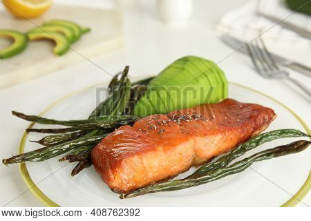 Tasty Cooked Salmon And Vegetables Served On White Table, Closeup. Healthy Meals From Air Fryer
