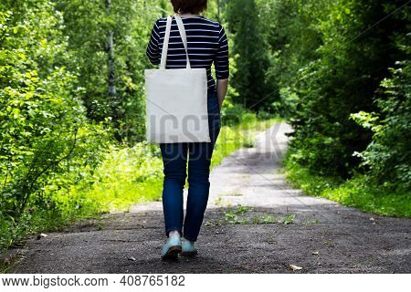 Woman In Striped T-shirt Holding Tote Bag Mockup