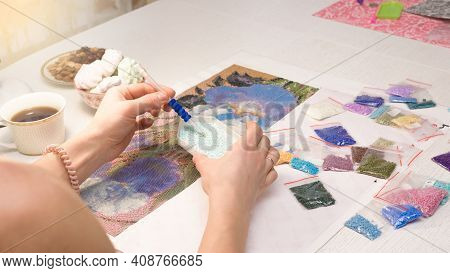 Home Hobby-to Draw Pictures Of Rhinestones, Multi-colored Diamond Mosaic. The Process Of Gluing Penc