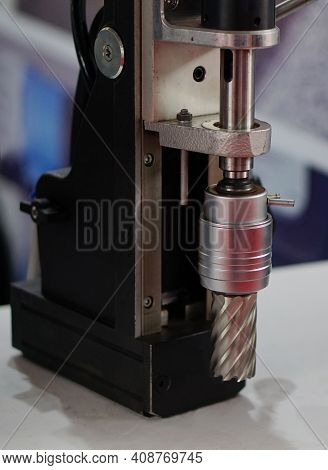 Close-up View Of A Metal Drilling Machine In A Industry