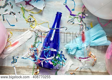 Top View Of Floor With After A Party Celebration With Empty Blue Bottles
