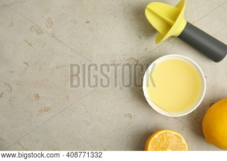 Freshly Squeezed Lemon Juice On Light Grey Table, Flat Lay. Space For Text