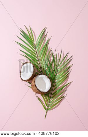 Creative Layout Made Of Coconuts And Leaves On Pink Background. Flat Lay, Top View. Food, Summertime