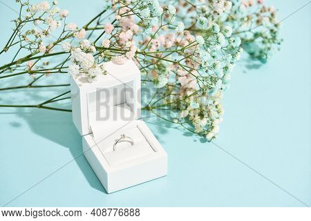 Romantic Surprise For Her. White Gift Box With Engagement Diamond Ring And Beautiful Fresh Spring Fl