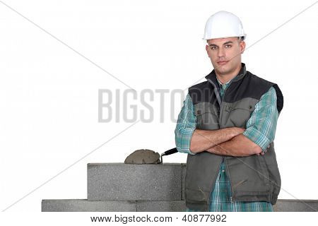 Tradesman standing by his work